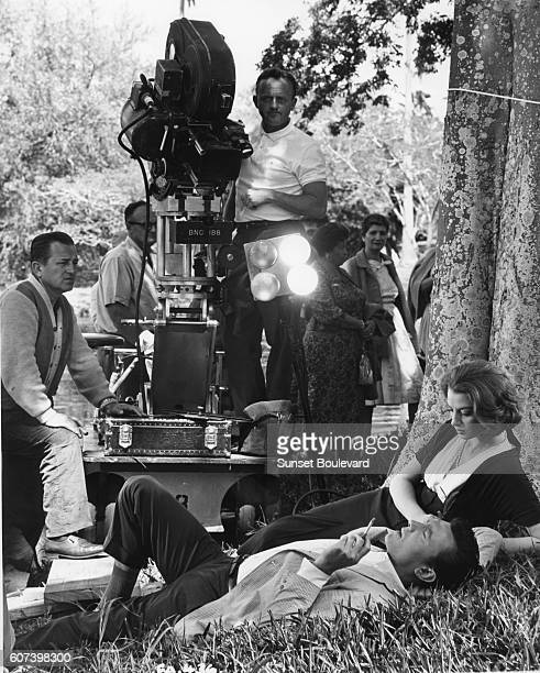 French actress Annie Girardot and Italian actor Renato Salvatori with director Luchino Visconti on the set of his movie Rocco e i suoi fratelli .