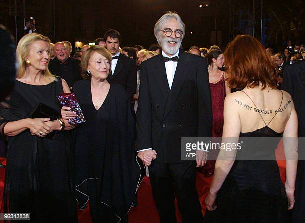 French actress Annie Girardot Austrian director Michael Haneke and French actress Isabelle Huppert with an inscription written on her back and arm...