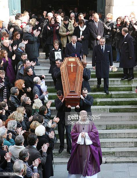 French actress Annie Girardot coffin is applauded at Saint-Roch church during her funerals, on March 4, 2011 in Paris. Girardot, who performed in...