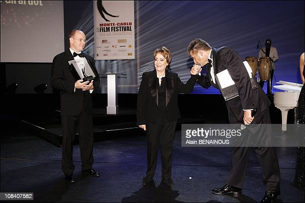 French actress Annie Girardot receives an award for her career from Prince Albert of Monaco in Monaco on November 12 2005
