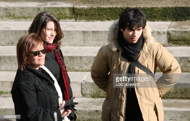 French actress Annie Girardot's daughter Giulia Salvatori , her granddaughter Lola and her grandson Renato wait for the beginning of the funeral of...