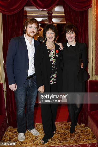 French actress Anny Duperey poses with her son Gael Giraudeau and his companion Anne Auffret after being awarded by the Legion d'Honneur at the...