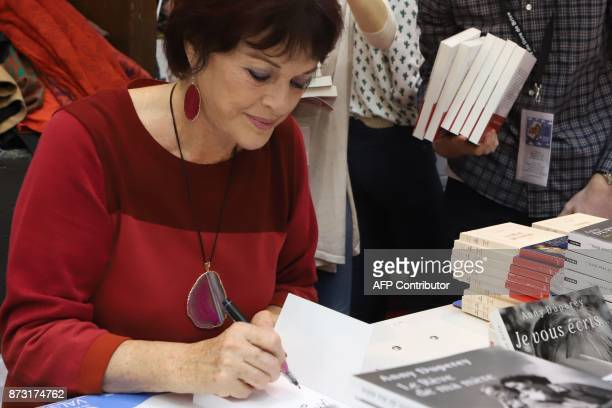 French actress Anny Duperey signs her book during the 36th edition of the 'Foire du Livre de Brive' book fair on November 12 2017 in BrivelaGaillarde...