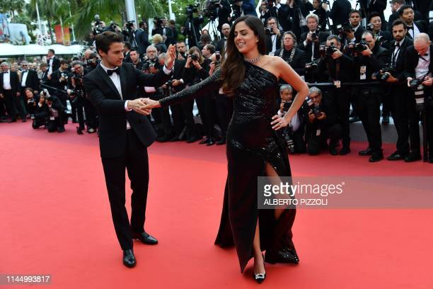 TOPSHOT French actress Anouchka Delon and her partner Julien Dereims arrive to attend the Honorary Palme d'Or being awarded to her father French...
