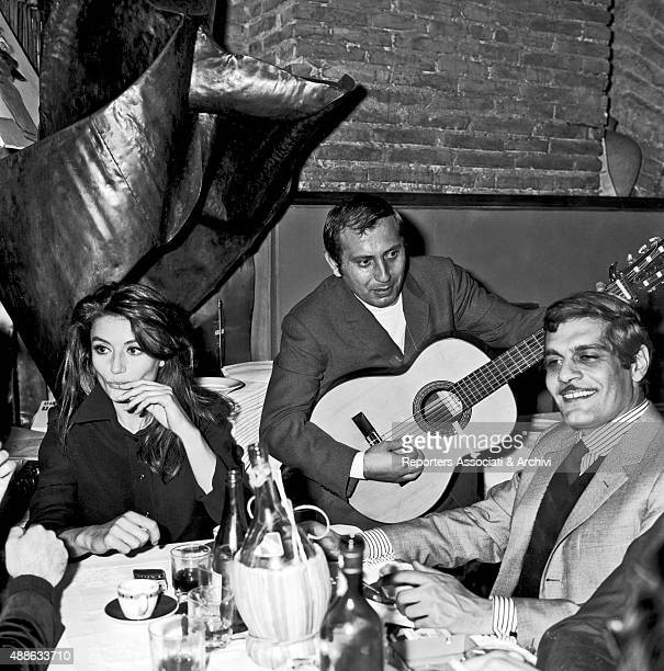French actress Anouk Aim'e and Egyptian actor Omar Sharif known as Omar El/Sherif and born Michel Demitri Shalhoub having dinner at the restaurant...