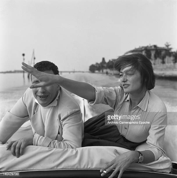 French actress Anouk Aimee portrayed while smoking a cigarette with her husband Alexandre Astruc lying on a boat Venice 1955
