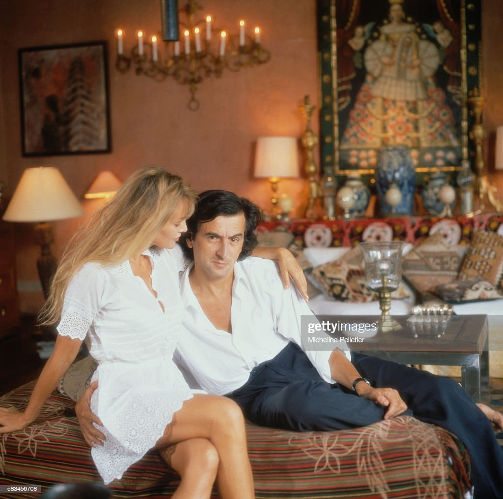 French actress Arielle Dombasle and French philosopher, writer and film director Bernard-Henri Levy sit on a sofa, in the living room of their residence in Mexico.