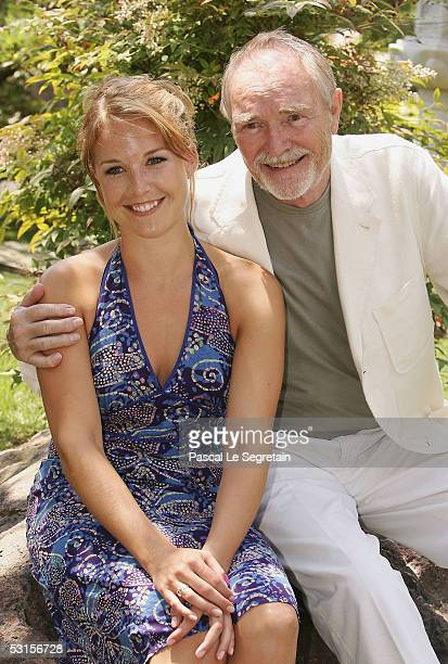 French Actress Aurelie Vaneck poses with her grand father Actor Pierre Vaneck during a photo call at the 45th Monte Carlo Television Festival on June...