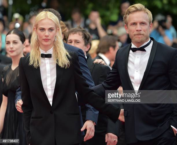 French actress Aymeline Valade and Belgian actor Jeremie Renier arrive for the screening of the film SaintLaurent at the 67th edition of the Cannes...