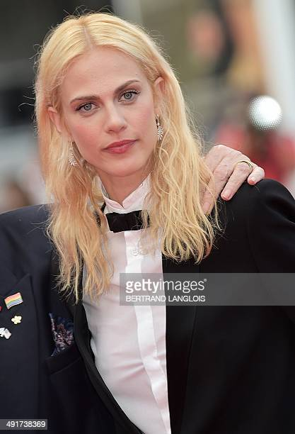 French actress Aymeline Valade poses as she arrives for the screening of the film 'SaintLaurent' at the 67th edition of the Cannes Film Festival in...