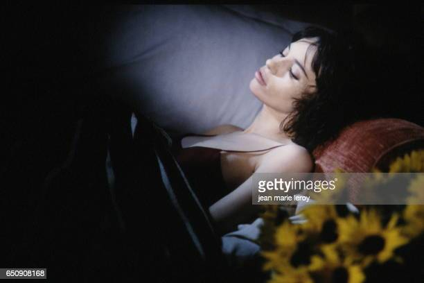 """French actress Béatrice Dalle on the set of """"A La Folie"""" by French director, screenwriter, producer and actress Diane Kurys."""