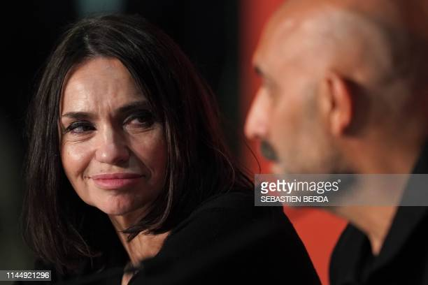 """French actress Beatrice Dalle looks at Argentinian director Gaspar Noe during a press conference for the film """"Lux Aeterna"""" at the 72nd edition of..."""
