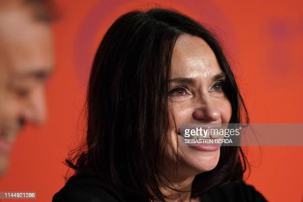 """French actress Beatrice Dalle smiles during a press conference for the film """"Lux Aeterna"""" at the 72nd edition of the Cannes Film Festival in Cannes,..."""