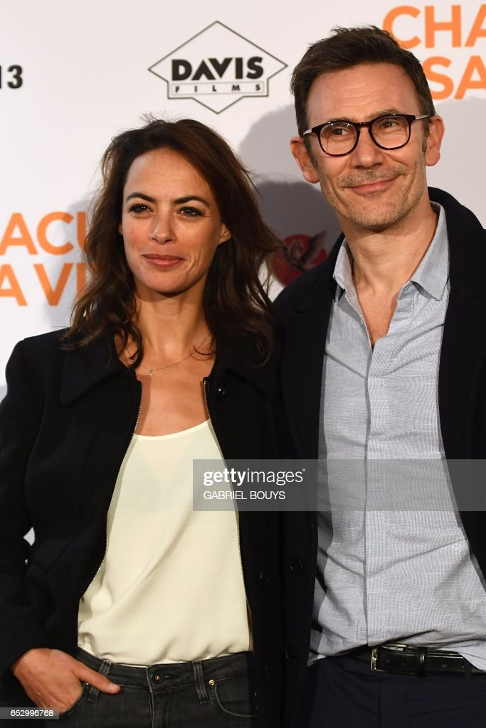 French actress Berenice Bejo and her husband French director Michel Hazanavicius pose during the photocall for the premiere of the film 'Chacun Sa Vie' in Paris on March 13, 2017. The film is directed by French director Claude Lelouch. /