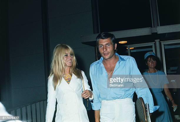 French actress Brigitte Bardot and her new husband, German industrialist Gunther Sachs, leave Los Angeles International Airport on a flight bound for...