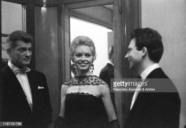 French actress Brigitte Bardot and Italian actor Franco Interlenghi smiling with French actor Jean Marais at the premiere of the film Love Is My...