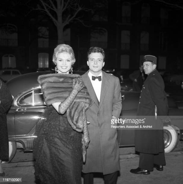 French actress Brigitte Bardot and Italian actor Franco Interlenghi smiling at the premiere of the film Love Is My Profession Paris 21nd January 1958