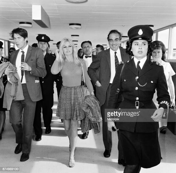 French actress Brigitte Bardot arrives at London airport as she visits England to film location scenes for a new Anglo French production 'Two Weeks...