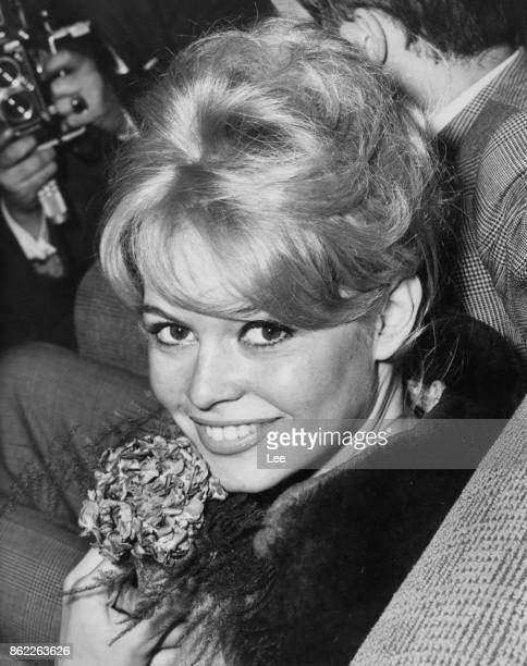 French actress Brigitte Bardot arrives at London Airport from Paris to film scenes for the movie 'Babette Goes To War' at RAF Abingdon 9th April 1959