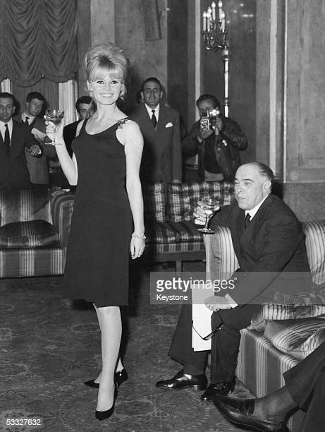 French actress Brigitte Bardot at a press conference in Rome to promote her new film 'Le Mepris' producer Carlo Ponti is on the right 22nd April 1963