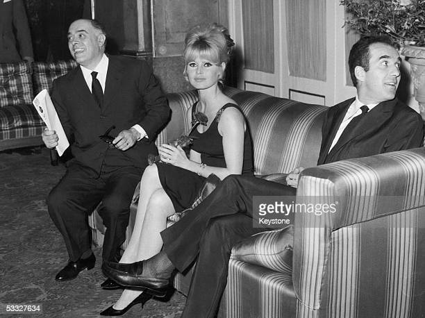 French actress Brigitte Bardot at a press conference in Rome to promote her new film 'Le Mepris' Producer Carlo Ponti sits on her left and director...