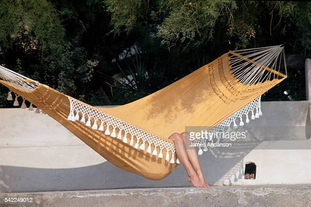 French actress Brigitte Bardot in a hammock at her home in StTropez La Madrague