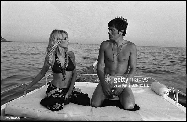 French actress Brigitte Bardot is pictured with French actor Alain Delon in SaintTropez in August 1968 France