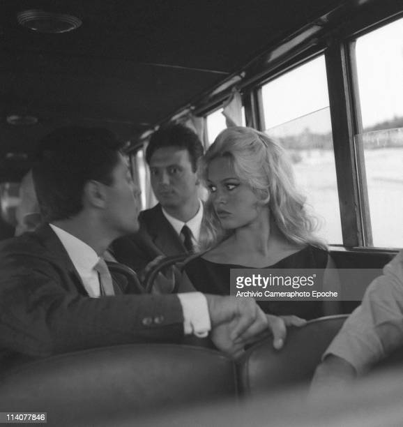 French actress Brigitte Bardot sitting on a vaporetto with Franco Interlenghi and Sasha Distel Venice 1958