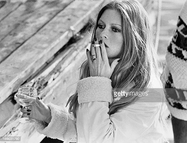 French actress Brigitte Bardot smokes a cigarette on the set of the film Don Juan 73 directed by Roger Vadim in Stockholm on September 30 1972 AFP...