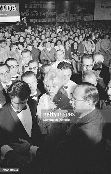 French actress Brigitte Bardot surrounded by the crowd at the 19th Venice International Film Festival Venice August 1958
