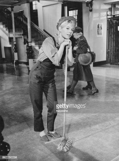French actress Brigitte Bardot sweeps the floor of the Free French headquarters in a scene from the film 'Babette Goes To War' 20th January 1959