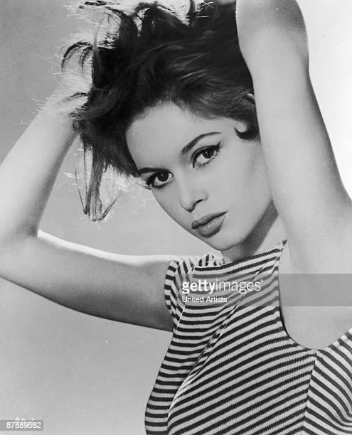French actress Brigitte Bardot wearing a striped vest top, 1958.