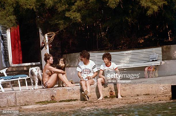 French actress Brigitte Bardot with her former husband actor and artist Jacques Charrier and their son NicolasJacques at La Madrague her property in...
