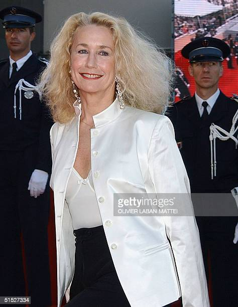 French actress Brigitte Fossey smiles as she arrives at the palais des festivals to attend the screening of French director Nicole Garcia's film...