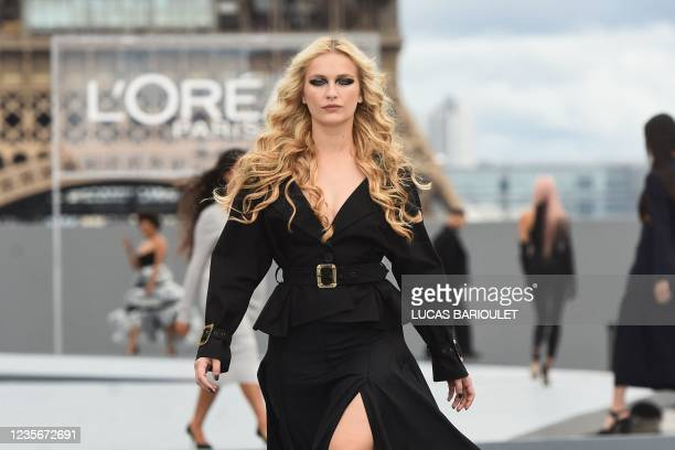 French actress Camille Razat presents a creation for L'Oreal on the sidelines of the Paris Fashion Week Spring-Summer 2022 Ready-to-Wear collection...