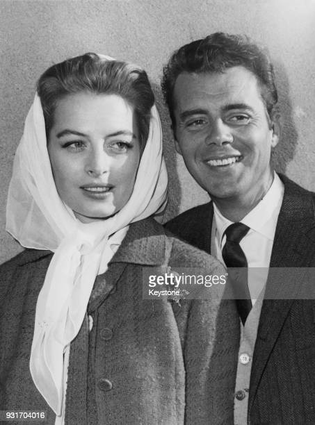 French actress Capucine is met by English actor Dirk Bogarde upon her arrival at London Airport from New York 17th August 1960 She is in the UK to...