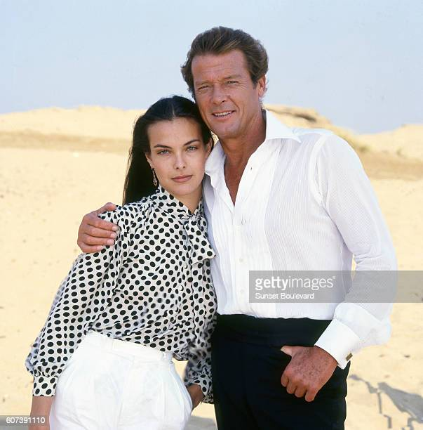 French actress Carole Bouquet and British actor Roger Moore on the set of For Your Eyes Only directed by John Glen
