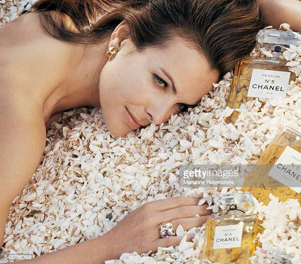 French actress Carole Bouquet the face of Chanel No 5 perfume poses in a field of jasmine