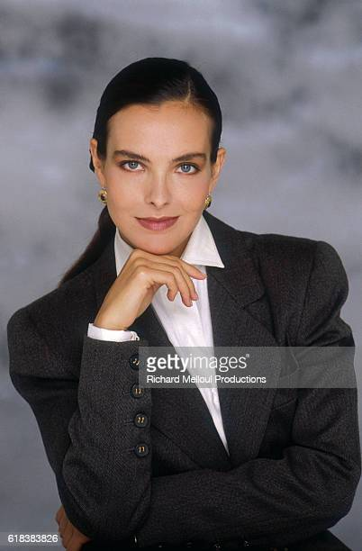 French actress Carole Bouquet wearing a dark gray blazer She became a spokeswoman and model for the Chanel fashion house in the 1990s