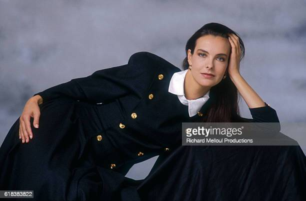 French actress Carole Bouquet wearing a long navy dress She became a spokeswoman and model for the Chanel fashion house in the 1990s