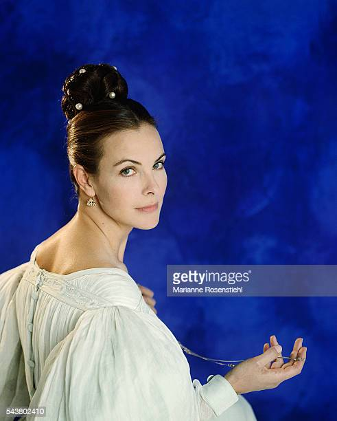 French actress Carole Bouquet wearing the dress from the 1997 French television film Le Rouge et le Noir.