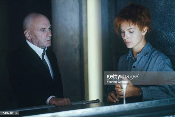 """French actress Carole Bouquet with actor Jean-Louis Trintignant on the set of the film """"Bunker Palace Hotel"""", directed by Yugoslav-born director and..."""