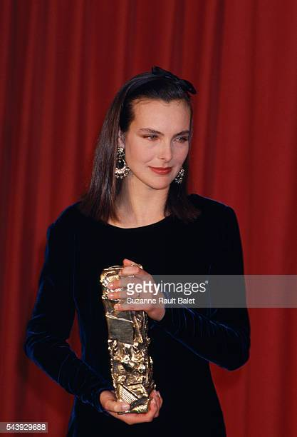 French actress Carole Bouquet with her 1990 Cesar award for best actress in Trop Belle pour Toi directed by Bertrand Blier