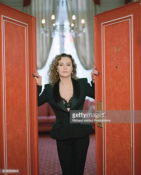 French actress Caroline Cellier opens the doors to her hotel room at Paris Hotel Scribe
