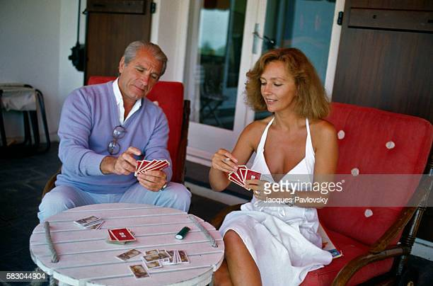 French actress Caroline Cellier plays cards with her husband Jean Poiret on vacation at their property in Bordagain near St Jean de Luz