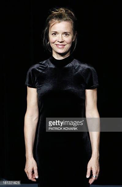 French actress Caroline Proust poses during a photocall as part of the presentation of L'enterrement on August 29 2012 in Paris L'enterrement a play...