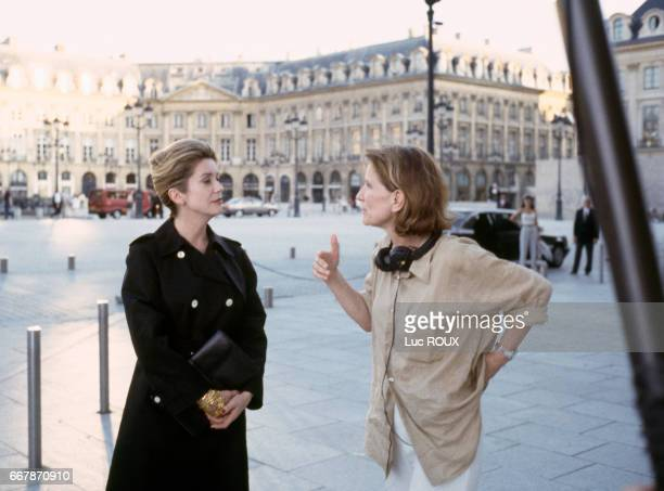French actress Catherine Deneuve and actress and director Nicole Garcia on the set of Garcia's film Place Vendome