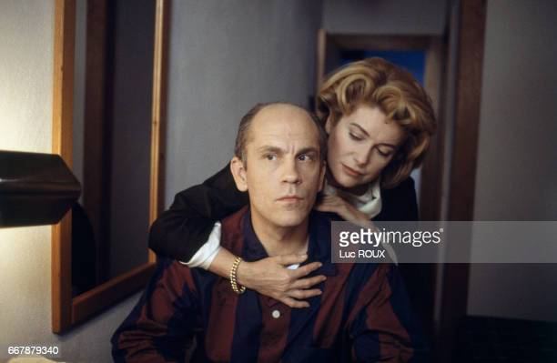 French actress Catherine Deneuve and American actor John Malkovich on the set of the film O Convento directed by Manoel de Oliveira