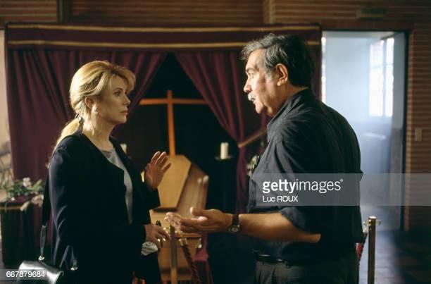 French actress Catherine Deneuve and Chilean director Raoul Ruiz on the set of Ruiz's film Genealogies d'un Crime