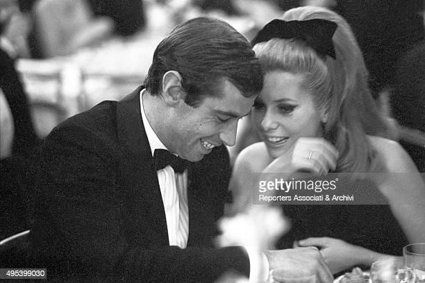 French actress Catherine Deneuve and French actor and director Roger Vadim smiling at the Paris Opera Gala for the presentation of the film Lafayette...